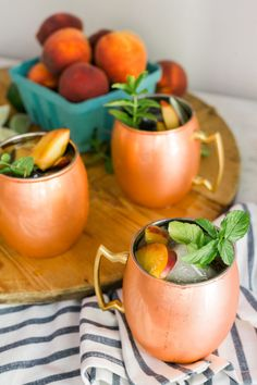 Top Atlanta blogger Mandy Kellogg Rye whips up a delicious Peach Moscow Mule just in time for summer. This Peach Moscow Mule uses Belvedere Peach Nectar ...