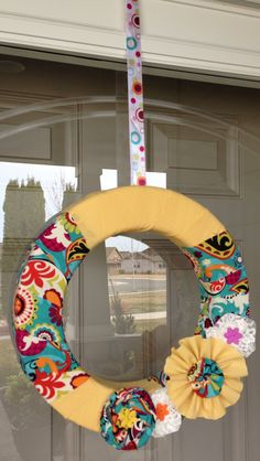 Summer wreath - a variation of this would work. I love the yellow flower matching the wreath with contrast between them.