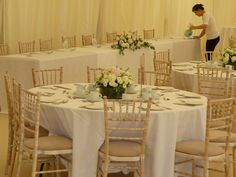 Chivari chairs in an ivory marquee. The distressed antique look is wonderful in a marquee.