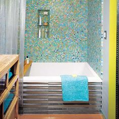 Craft a rustic and rustproof surround for your drop-in bathtub out of corrugated, galvanized-steel roof paneling.     A 12-by-12-foot sheet, enough for one side of a tub (as shown), is about $18 at homedepot.com.  Probably wouldn't use the glass tiles though!