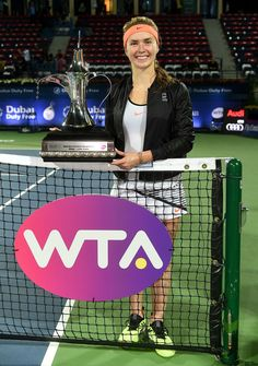 Elina Svitolina Photos Photos - Elina Svitolina of Ukraine poses with the trophy after winning the final match against Caroline Woznacki of Denmark on day seven of the WTA Dubai Duty Free Tennis Championship at the Dubai Tennis Stadium on February 25, 2017 in Dubai, United Arab Emirates. - WTA Dubai Duty Free Tennis Championship - Day Seven