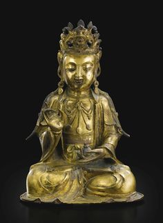 A Chinese gilt-bronze seated figure of Guanyin, Ming dynasty, 16th-17th century