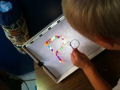 Litebrite letters! Fine motor strengthening, visual motor skills, and kinesthetic learning of letter formation.
