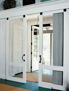 This is a great idea for rolling barn door hardware. It gets the screen doors out of the way, but you can still see through them, if need be.