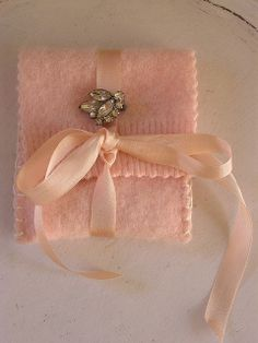 Felted Jewelry Pouch - use the end of a sleeve or the bottom of a felted old wool sweater - super cute idea!