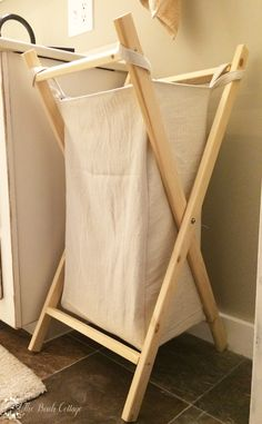 Learn how to make this foldable DIY laundry hamper . The hamper is constructed of inexpensive furring strips and the bag is easy to sew and reversible! Furniture Projects, Wood Furniture, Furniture Design, Furniture Makeover, Art Projects, Small Laundry Rooms, Laundry Room Organization, Laundry Hamper, Home Furnishings