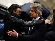 The two managers, Luis Enrique of Barcelona and Manuel Pellegrini of Manchester City, embrace before the game kicks off