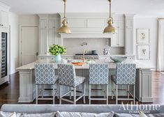 Four gray geometric counter stools sit at a white and gold marble countertop accenting a gray island and fitted with a sink and a brass gooseneck faucet lit by two Country Industrial Pendants. Grey Kitchen Island, Kitchen Dining, Gray Island, Light Grey Kitchens, Kitchen Designs Photos, Kitchen Photos, Building A New Home, Transitional Kitchen, Counter Stools