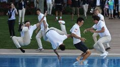 Pro tennis player Kei Nishikori, second from right, is thrown into a pool after winning the final of the Barcelona Open on Sunday, April 27, 2014.