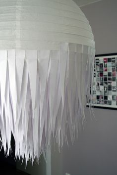 DIY Swedish design lamp (using a plain IKEA rice paper lamp and strips of printer paper). Instructions in Swedish, but the pictures are easy to understand.