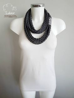 Handmade scarf/ necklace. Made of high quality grey mélange cotton fabric. The fabric is very soft and pleasant to wear. Can be worn long or folded. For cleaning, wash by hand and dry naturaly. Size: length 65cm Feel free to contact me for any question regarding this item. Please visit me on facebook: https://www.facebook.com/lulaor And Instagram: www.instagram.com/lulaorcrochet
