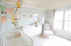 White Nursery with Pops of Color in the Decor @Ashli Longie