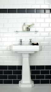 Black and white metro tiles for bathroom - black at bottom and as basin splashback, white above to ceiling