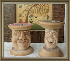 Hand carved faces on vintage thread spools