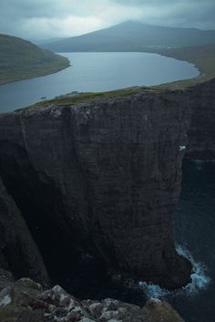 Lake Sørvágsvatn in the Faroe Islands. The lake is about 30 m above the ocean below but the photo was taken on a cliff... - http://silestine.tumblr.com/post/56448337734