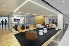 Reclaimed wood flooring was used to visually connect the space: starting with the transaction top of the reception desk (with integrated back lit logo), ...