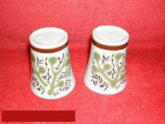 Noritake Green Tree #8328 Salt & Pepper by Noritake - Primastone. $14.94. Dimensions: N\A. Mint Condition. Salt & Pepper - Central Abstract Green Tree And Stylized Leaves And Flowers In Brown - White Body - Brown Accent Band - Made In Japan