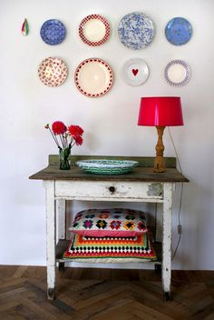 Pretty dishes on the wall for a lovely home decor idea