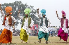 Villagers performing the traditional dance of Punjab, the Bhangra, at the Rural Olympics