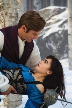 Lily Collins as Snow White and Armie Hammer as Prince Andrew Alcott