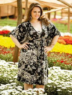 Great printed wrap around dress on Plus size model Manu Maciel