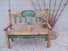 Beautiful wood bench.    Seashell design.    Green and teal/aqua/turquoise accents.    55 inches wide, 48 inches tall x 24 inches deep    Bench back has a slight decline for comfort.    Distressed rustic style, hand made in Mexico. SOLD