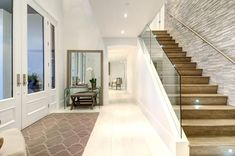 modern foyer/stair design; gray stone wall & accents
