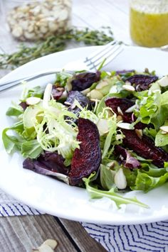 Sweet roasted beets combine with creamy avocado, crunchy almonds, and tender spring mix in this healthy salad. Drizzle it with a citrus-thyme vinaigrette for the perfect spring dish.