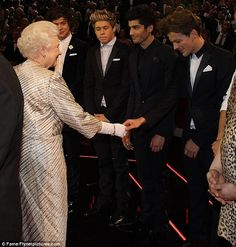 Queen Elizabeth meets members of the band New Direction