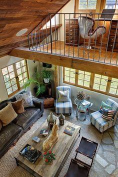 Great room living area with loft office area above in the Tuxedo Park Residence