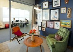 Yes to cozy yet clean work spaces. residential like furniture in an office environment. nice!
