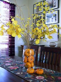 fall centerpiece...could use plain branches in the vase with the pumpkins