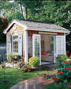 The Quaint Escape: With a cozy daybed and French doors that swing open to a charming and lush garden, this she-shed is the ultimate spot for whiling away a summer afternoon. house 17 Charming She-Sheds to Inspire Your Own Backyard Getaway Backyard Storage Sheds, Storage Shed Plans, Backyard Sheds, Outdoor Sheds, Outdoor Storage, Diy Storage, Backyard Studio, Storage Ideas, Backyard Retreat