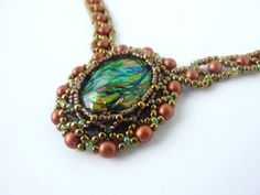 DIY Jewelry: FREE beading pattern for an 18x25mm cabochon netted bezel with Russian Snake chain, made with 11/0 and 15/0 seed beads, and 4mm copper pearls.~ Seed Bead Tutorials