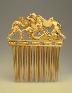 Comb with a Scythians in Battle. Place: Russia (now Ukraine). Epoch. Period: Early Iron Age. Date: Scythian Culture. Late 5th - early 4th century BC. Place of finding: Solokha Barrow. Entrance Grave. Archaeological site: Dnieper Area, Zaporozhye Region. Material: gold. | © 1998 - 2015 The State Hermitage Museum.
