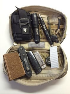 Mini-Urban Survival Kit: The contents include: SureFire E1B Backup Light,SureFire Pen II, Law Industries Mini SERE Pouch with entry kit, Emerson EDC-1 Multitool, Suunto clip, compass, Mini Leatherman tool, Lighter, Micro Photon Light (red)