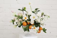 Whites, creams, and citrus pops for Christina's wedding in Downtown LA.