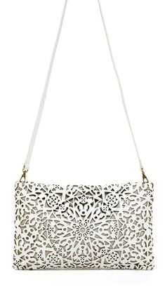 Laser cut leather handbag with decorative surface pattern; lasercut fashion