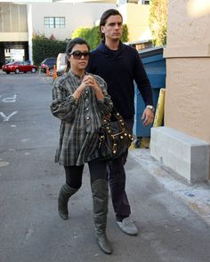 Kourtney Kardashian: While pregnant with son, Mason, Kourtney Kardashian kept up her on-trend style with over-the-knee boots and a plaid tunic.