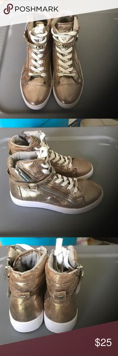 MICHAEL Michael Kors Size 2 Girls Sneakers Michael Kors size 2 sneakers worn maybe 10 times. Brand new at Bloomies right now for $65!!  This is a steal!!! Item comes from a smoke/pet free home.  Local pick up in NJ (Green Brook) or will ship (shipping extra depending on location) Payment accepted via cash, Paypal, or Venmo.  Item used - in like new condition. MICHAEL Michael Kors Shoes Sneakers
