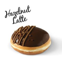 Krispy Kreme // Hazelnut Latte - Hand-dipped in milk chocolate praline, filled with mild coffee kreme then decorated with coffee icing and caramelised hazelnut pieces.
