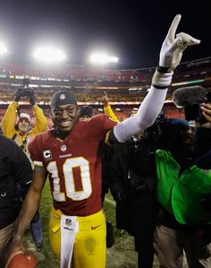 DECEMBER 30: Quarterback Robert Griffin III #10 of the Washington Redskins celebrates after the Redskins defeated the Dallas Cowboys 28-18
