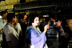 Geiko Sayaka with an iPhone at Gion Matsuri, or: I want to go back to Kyoto.