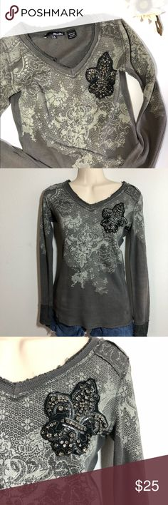 Miss Me Lace Print Rhinestone Embellished Tee This waffle knit long sleeve gray tee shirt features a light gray lace print on the front and back shoulders and sleeves. The cuffs and neckline are both lightly distressed and frayed. The left chest is embellished with a black patch in the shape of a fleur-de-lis that is covered with rhinestones (which are stitched a little loosely to allow them to move, creating extra sparkle) and beads.  Women's small, Bust (pit to pit, flat lay)…