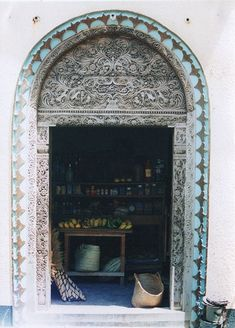 Carved wooden door (open) at Lamu in Kenya. These traditional Swahili doors are seen on many older buildings in Lamu. Kenya