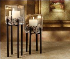 Transitional Iron Metal Candle Holder Set by San Miguel. $43.30. Candles and Stones included. Enhance your Tuscan, Mediterranean, or Transitional decor. Transitional Wrought Iron Candle Holder Set. In Stock. Rustic brown metal with glass holders. This set of candleholders will have a calming effect on any room you display them in. Simple lines, warm candlelight and grey tone pebbles will enhance your Tuscan, Mediterranean, or Transitional decor. Enjoy them in y...