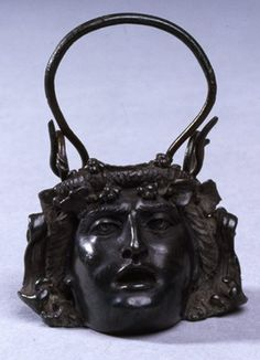 Bronze vessel in the form of a youthful Bacchic head, with a handle. 1st century, found in Netherlands.
