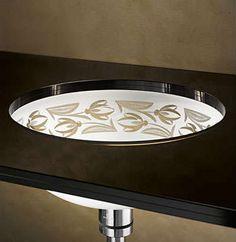 Rimless Cut Glass Sink Lit From Below.