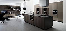 Wonderful integration of the living room and kitchen environments Kalea: Posh Modern Kitchen Offers Versatile Design Solutions