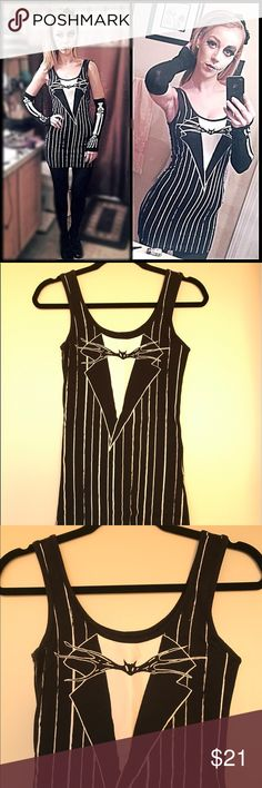Nightmare Before Christmas Jack Skellington Dress Tim Burton's Nightmare Before Christmas Jack Skellington Dress! I have only worn this dress once for Halloween. It is made out of 95% cotton and 5% spandex. Great Halloween costume or dress for an event! Disney Dresses Mini